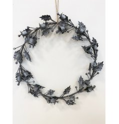 this hanging metal wreath will be sure to add character to any front door or home space at Christmas time