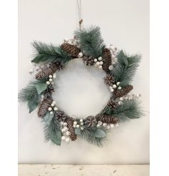 A charmingly simple round wreath built up of Alpine branches, pinecones and berries