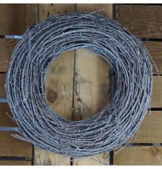 Made up of only white washed twigs, this large chunky wreath will be sure to hang perfectly on any front door during Chr