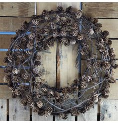 A charmingly simple natural toned twig wreath with an added decal of mini pinecones