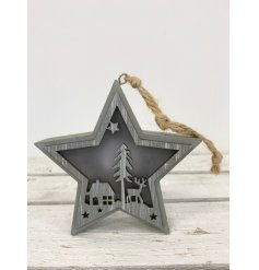 this wooden star decoration with a cut out woodland scene will be sure to bring a festive feel to any home space