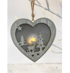Set with a beautiful warming LED glow, this wooden heart decoration with a cut out woodland scene will be sure to bring