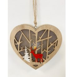 A beautifully made wooden hanging heart decoration, complete with an added cut woodland scene and warm glowing LED centr