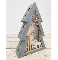 A grey toned wooden tree complete with a Woodland inspired cut out scene and added warm glowing LEDs for decoration