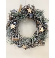 Bring a charmingly chic edge to your home decor or front door at Christmas with this beautifully decorated wreath