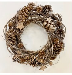 A beautifully natural toned woven twig wreath with added frosted features and pinecone decal