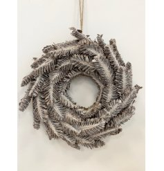 A medium sized round wreath made up of wooden accents in the form of feathers