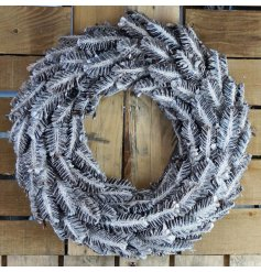A grey washed toned wreath with an added frosted decal