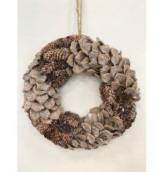this assorted sized pine oasis wreath will be sure to bring a rustic charm to any front door