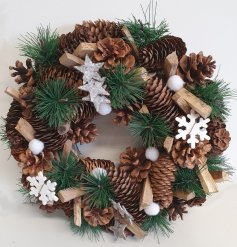 A large hanging wreath decorated with an array of wooden accents and features
