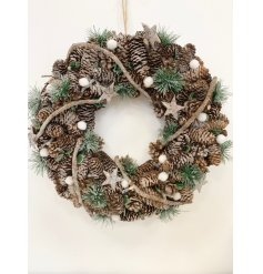 Beautifully clustered together, this wreath is made up of frosted pinecones, berries, stars and pompoms