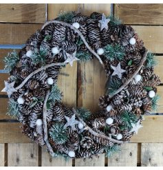 this frosty finished wreath with a woven twig decal will be sure to hang beautifully on any front door