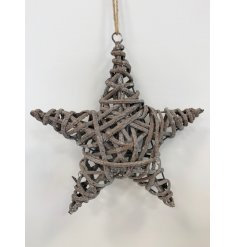 A large hanging grey toned star made up of rustic woven rattan and hung from a jute string