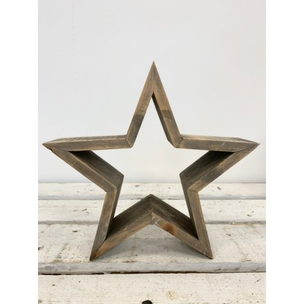 A chunky wooden 3D star decoration. An on trend interior accessory and seasonal decoration.