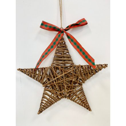 A traditional wicker star decoration with a large tartan ribbon and jute string hanger.