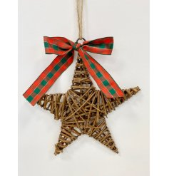 A rustic star shaped wreath with a traditional tartan bow and jute string hanger.