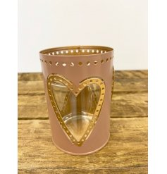 A pretty metal candle holder in muted gold and pink colours. A chic interior accessory for the home.