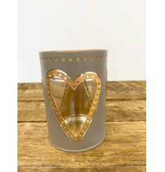 A stylish glass candle holder in muted grey and gold colours. A lovely gift item and interior accessories.