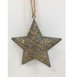 An antique inspired metal star decoration with a scalloped edge and decorative star pattern.