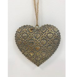 An antique inspired metal heart decoration with a pretty scalloped edge and gold star pattern.