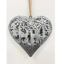A chic metal heart decoration with a laser cut reindeer scene and frosted snow finish.