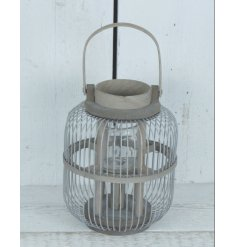 Bring a simple charm to any interior with this stylishly chic metal wire lantern complete with wooden accents