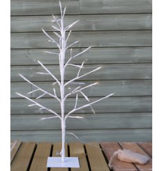 Bring a warming glow into any home space with this beautifully simple white twig tree