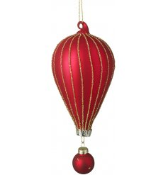 A beautiful and unique hot air balloon glass bauble with gold glitter detailing.