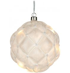 A beautifully decorated glass bauble featuring a warm glowing LED centre, frosted surround and embossed diamond ridge