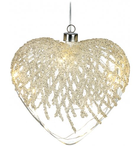 A stunning heart shaped glass decoration with an intricate cascading lattice pattern made from beading.