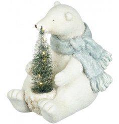 Bring a beautifully wintered feel to your home decor at Christmas with this charming sitting polar bear decoration