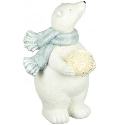 A beautiful polar bear ornament with a sparkling finish and a light up snowball.