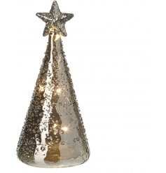 A stunning and unique glass tree ornament with a textured bubble finish and twinkling LED lights.