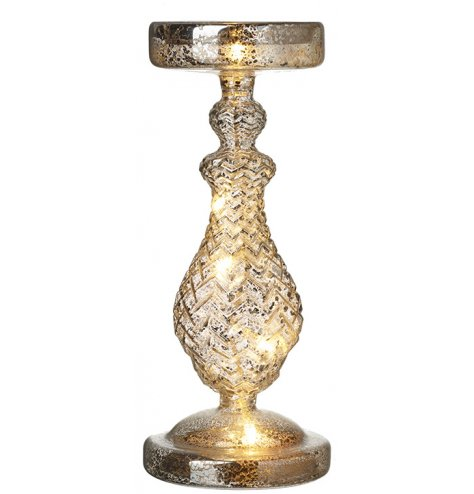 An antique inspired glass candlestick with a mottled surface and ridged pattern. Complete with LED lights.