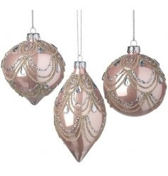 Assorted by their shapes, this beautiful mix of blush pink glass baubles each feature a glittery champagne gold decal