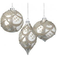 A gorgeous assortment of glass baubles set in a pearl white tone, with their assorted shapes and champagne gold glitter
