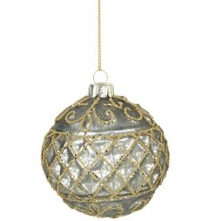 A highly decorative glass bauble with a mottled finish and gold glitter decorative pattern.