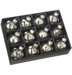 A box filled with charming little glass baubles each decorated with a mottled silver tone and added glitter star