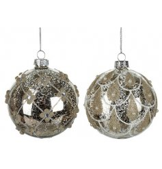 An assortment of large glass baubles, assorted by their glittery gold patterns and decals
