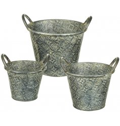 A set of 3 rustic metal buckets, each with twin handles and a decorative engraved pattern.
