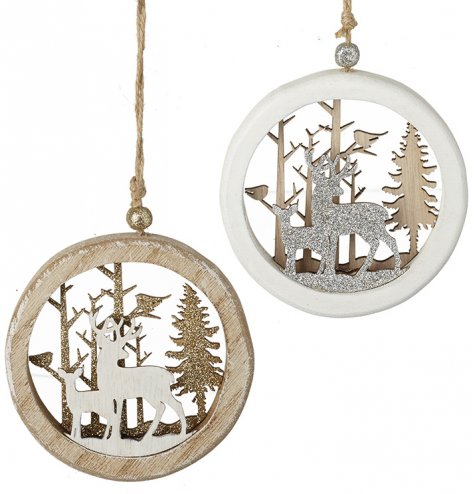 Wooden baubles in natural and white colour assortments with intricate, layered woodland scenes.
