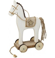 A delightful little white wooden horse sweetly presented on wheels