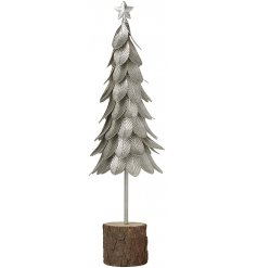 A stylish silver leaf tree ornament with star topper. Set within a rustic bark base.
