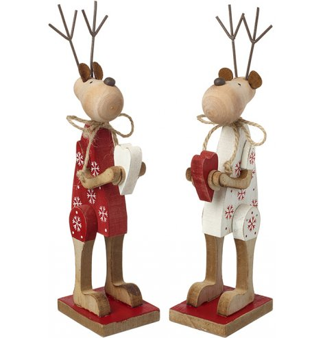 An assortment of rustic red and white jointed reindeer ornaments with a vintage toy aesthetic.