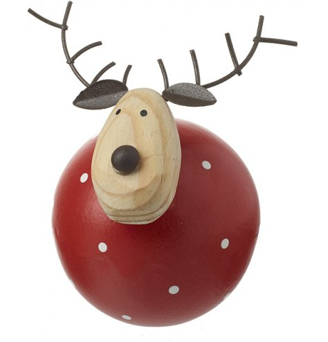 A unique round reindeer decoration with a red and white polka dot body, metal antlers and nose.
