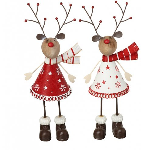 Charming red and white metal reindeers with a distressed, vintage inspired finish.