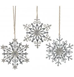 A charmingly simple assortment of Snowflake shaped hanging decorations in a metal silver tone