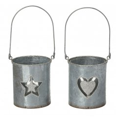 A charming mix of distressed metal pots featuring a laser cut star and heart decal