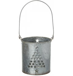 A rustic metal candle holder featuring a star cut tree decal and added glitter rim top
