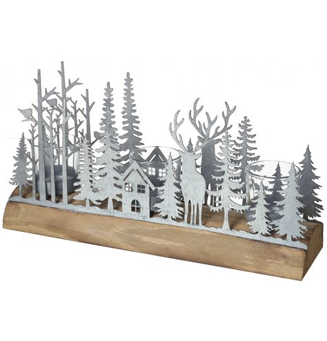 A unique 3 x candle holder decoration featuring an intricate woodland scene in zinc.